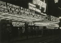 Crowd outside the Criterion Theater at night with marquee advertising An American Tragedy, Times Square, New York City.