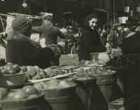 Women with barrels of produce, Lower East Side, New York City.