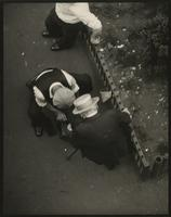 """Nickel a shine on the street"" [overhead view of shoe-shiner and customer]."