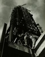 Workers on Empire State Building tower during constrution.