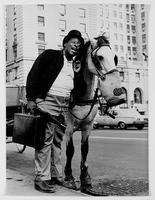 [Godfrey Cambridge and a carriage horse, 1968].
