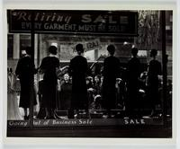 [Window display of women's clothing for a 'going out of business' sale, circa 1920s-1930s].