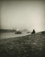 View across the East River showing seated person, boats, and industrial buildings.
