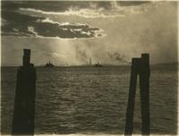 """Sunset No. 3"" [view from Battery Park across New York Harbor toward the Statue of Liberty in August]."