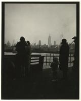 Passengers on the 42nd Street Ferry looking toward the Manhattan skyline.