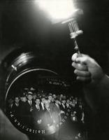 """Opening Night"" [photomontage of crowd outside theater with photographer's flash bulb and camera lens]."