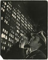 """Calling in the Night"" [photomontage of a man shouting and an unidentified building at night]."