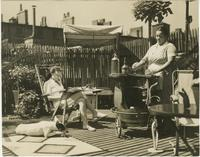 Women and dog on rooftop deck of Arthur Shettle residence, Washington Mews, New York City.