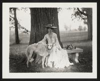 Unidentified woman outdoors with dog, undated [circa 1900-1910].