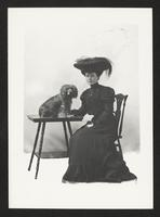 Unidentified woman with dog, undated [circa 1900-1910].