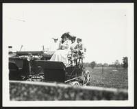 Baltimore Horse Show, unidentified men and women sitting in automobile, undated [circa 1900-1910].