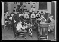 """Angelo"" with other boys in drawing class led by Maxwell B. Starr at Tompkins Square Building [i.e. Harriman Clubhouse], Lower East Side, New York City."