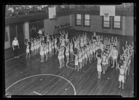 """Angelo"" among the boys exercising in gymnasium at Tompkins Square Building [i.e. Harriman Clubhouse], Lower East Side, New York City."
