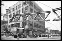 Fulton Street El, Brooklyn, at Jay Street, June 25, 1941. A 25 ton girder required cutting to remove it without damaging the trolley wires.