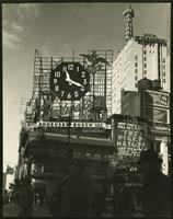 Budweiser malt billboard with clock at Broadway and 46th Street, New York City.