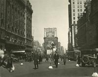 View of Times Square looking north from Broadway and 44th Street showing Hotel Astor and Loews State Theater.