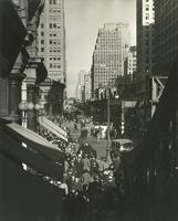 View of Sixth Avenue looking north from 34th Street showing elevated railroad and New York Herald Building.