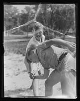 A vigorous handshake between two boys at Willliam Carey Camp, Jamesport, New York.