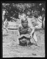 Boy holding a turtle at Willliam Carey Camp, Jamesport, New York.