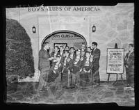 Group of Boys' Club members in front of the Boys' Clubs of America exposition at the 1939 New York World's Fair, Flushing Meadows, New York City.