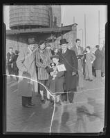 Boy with dog and unidentified officials during pet show on the roof of the Tompkins Square Building [i.e. Harriman Clubhouse], Lower East Side, New York City.