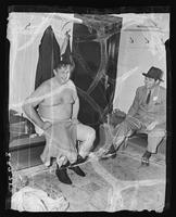 Men in dressing room after charity softball game at Madison Square Garden (1925-1968), Midtown Manhattan, New York City.