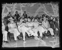 Members of the Nine Old Men seated during charity softball game at Madison Square Garden (1925-1968), Midtown Manhattan, New York City.