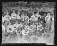 Group portrait of the Believe-It-Or-Nots softball team with Robert Ripley and Babe Ruth at Madison Square Garden (1925-1968), Midtown Manhattan, New York City.