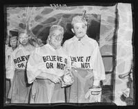 Members of the Believe-It-Or-Nots softball team in costume at Madison Square Garden (1925-1968), Midtown Manhattan, New York City.