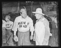 Babe Ruth in Believe-It-Or-Nots costume with a member of the Nine Old Men at Madison Square Garden (1925-1968), Midtown Manhattan, New York City.