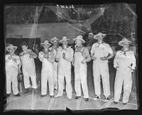 Members of the Nine Old Men softball team in costume at Madison Square Garden (1925-1968), Midtown Manhattan, New York City.