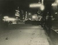 View of Broadway in winter at night looking south from near 51st Street, New York City.