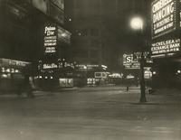 Night view of 48th Street in the snow, looking west from 7th Avenue, New York City.
