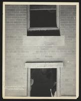102 Oliver Street, cracks near basement and parlor windows, Manhattan