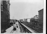 View of a Sixth Avenue El train looking north from W. 8th Street, 1885. Copy photograph dated May 24, 1940.