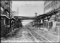 Elevated railroad tracks over  Greenwich Street, Manhattan, May 1876. View looking north from Harrison Street.