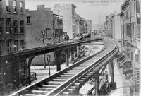 Elevated railroad tracks over  Greenwich Street, Manhattan, 1876. View looking north from Bank Street.
