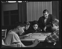 Boys playing carrom at the Tompkins Square Building [i.e. Harriman Clubhouse], Lower East Side, New York City.