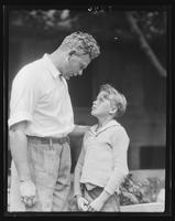 Camp superintendent William H. Kiss speaking with a boy at William Carey Camp, Jamesport, New York.