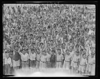 Large group portrait of campers waving at William Carey Camp, Jamesport, New York.
