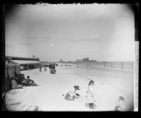 Beachgoers on Brighton Beach, Brooklyn, New York City, undated (ca. 1890-1900). The Manhattan Beach Hotel visible in the distance.