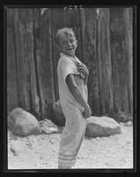 Boy wrapped in a towel at William Carey Camp, Jamesport, New York.