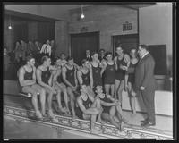 Group portrait of teenage boys' swim team beside pool.