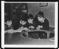 Young boys drawing at the Tompkins Square Building [i.e. Harriman Clubhouse], Lower East Side, New York City.