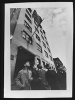 Boys standing outside the Tompkins Square Building [i.e. Harriman Clubhouse], Lower East Side, New York City.