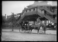 Hansom cab, statue of Horace Greely, and an elevated train station in Greely Square, New York City, 1898.