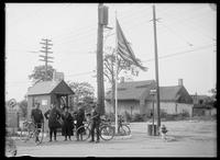 Unidentified women with Bronx police officers near a Dutch farmhouse on the corner of Borden Avenue and Laurel Hill Boulevard, Bronx, New York City, undated (ca. 1890-1910).