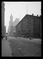Astor House seen from just above Barclay Street, looking south down Broadway, New York City, 1913. Singer building visible in the distance.
